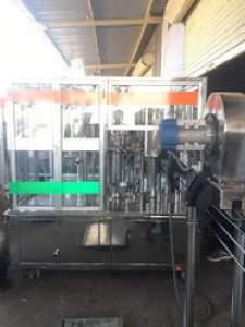 Rotary Bottle Filling Machine (Capacity: 120 - 150 Bottles/Minute)