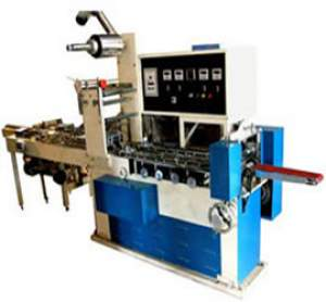NB-09 HORIZONTAL FLOW WRAPPING MACHINE TO PACK VARIETY OF SOLID SHAPES & MATERIALS